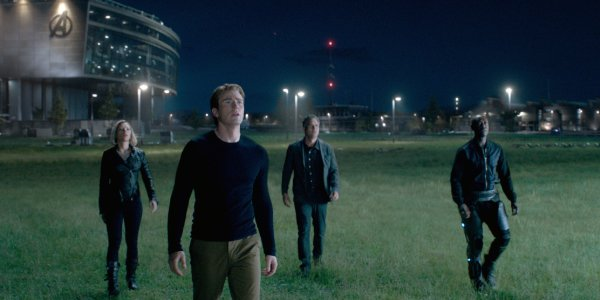 Avengers: Endgame some Avengers standing in a field, looking towards the sky