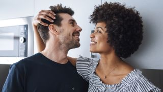 a man and woman looking at each other's hair
