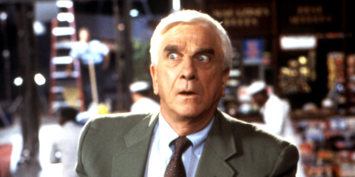 Leslie Nielsen as Lt. Frank Drebin in The Naked Gun: From the Files of Police Squad!