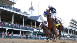 Authentic #18, ridden by jockey John Velazquez #18 crosses the finish line of the delayed Kentucky Derby in 2020.