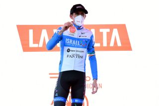 VINUESA SPAIN OCTOBER 22 Podium Daniel Martin of Ireland and Team Israel StartUp Nation Celebration Mask Covid safety measures Trophy during the 75th Tour of Spain 2020 Stage 3 a 1661km stage from Lodosa to La Laguna Negra Vinuesa 1735m lavuelta LaVuelta20 La Vuelta on October 22 2020 in Vinuesa Spain Photo by David RamosGetty Images