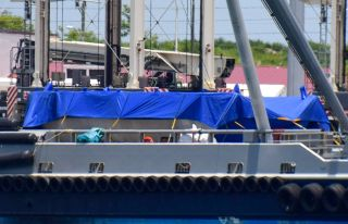 A blue tarp on the deck of the ship GO Ms. Tree covers the first payload fairing SpaceX has ever managed to pluck out of the sky.