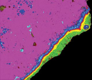 False-color compositional X-ray image of the rim and margin of a 4.57 billion-year-old calcium-aluminum-rich inclusion (CAI) from the Allende meteorite. Analysis of oxygen isotope abundances clued scientists in to the huge distances this chunk of space ro