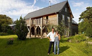 Couple outside an oak frame self build