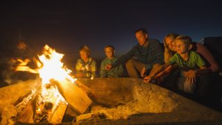 campfire safety: family toasting marshmallows on a campfire