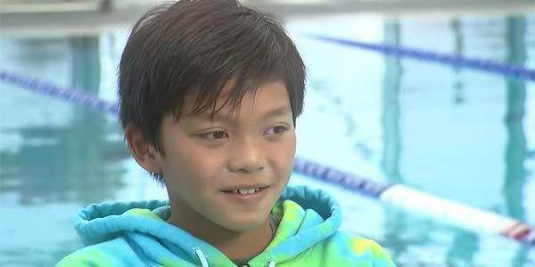 clark kent swimming record