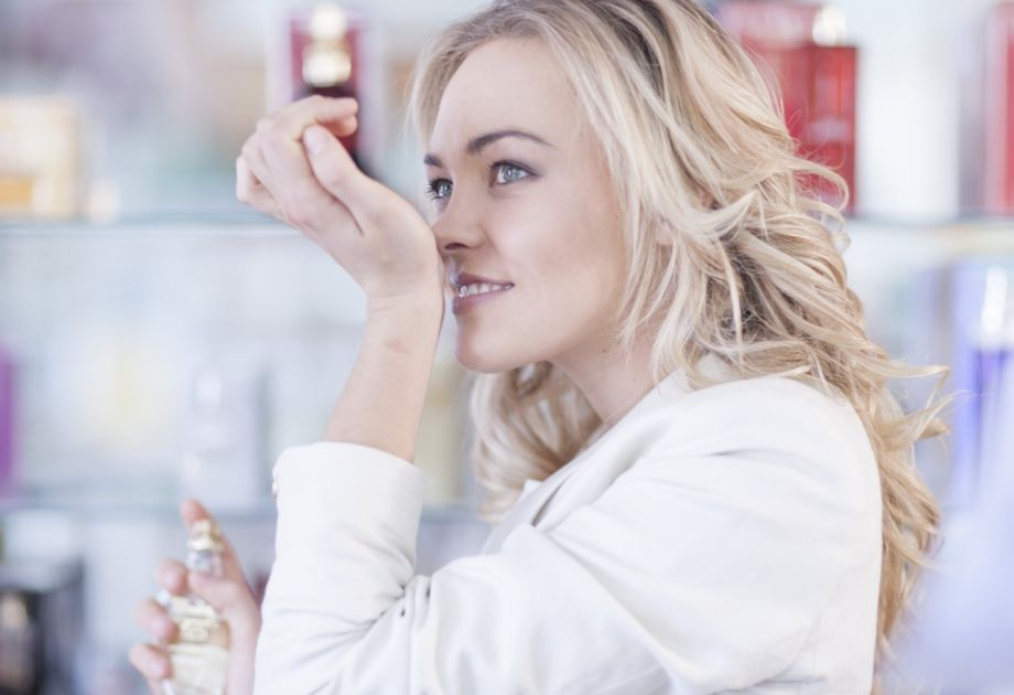 woman smelling her wrist
