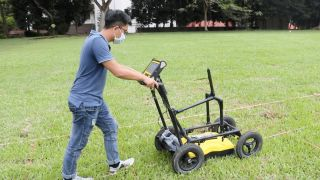 Archaeologists are investigating a football field behind Alexandra Hospital in Singapore that is thought to cover the mass grave of victims of a massacre in 1942.