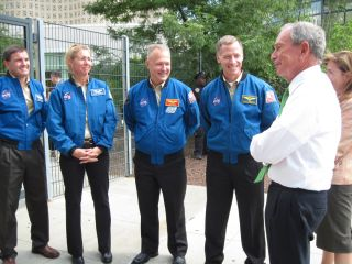 New York City Mayor Michael Bloomberg, right, greeted the STS-135 astronauts at the New York Hall of Science Aug. 17, 2011.