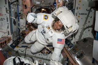 NASA astronaut Jack Fischer gives a thumbs-up sign while wearing an extravehicular mobility unit (EMU) spacesuit ahead of a May 12, 2017 spacewalk at the International Space Station.