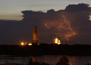 Lightning Slows Space Shuttle's Launch Pad Trek