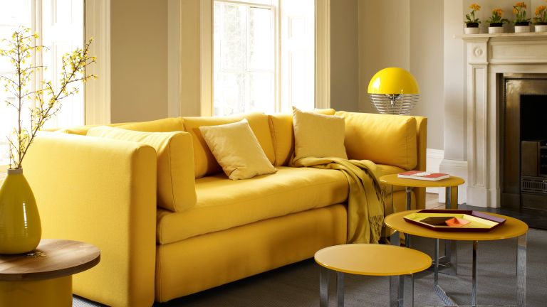 Yellow living room with yellow sofa and striped curtains