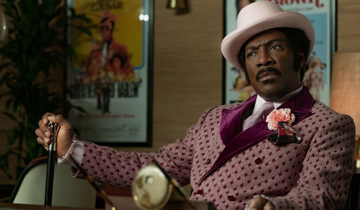 Dolemite Is My Name Eddie Murphy sits in full costume