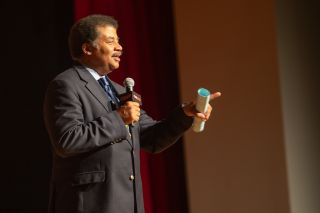 "Celebrity astrophysicist Neil deGrasse Tyson, host of ""StarTalk,"" talks to the crowd at New York Comic Con on Oct. 3, 2019."