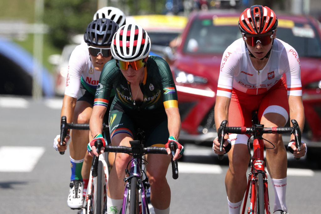 LR Namibias Vera Looser South Africas Carla Oberholzer and Polands Anna Plichta ride in a breakaway group as they lead the womens cycling road race of the Tokyo 2020 Olympic Games after the race start at Musashinonomori Park on the outskirts of Tokyo Japan on July 25 2021 Photo by MICHAEL STEELE POOL AFP Photo by MICHAEL STEELEPOOLAFP via Getty Images
