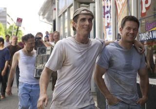 Christian Bale and Mark Wahlberg walk down a street together
