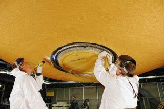 Shuttle Fuel Tank Workers Ding Foam Insulation