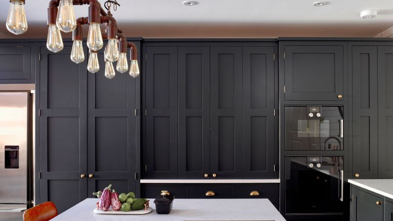 kitchen with dark kitchen cabinets by Bespoke kitchen designers Higham Furniture