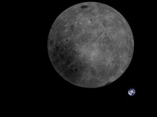 Earth photobombs the far side of the moon in this color-corrected photo taken by China's Longjiang-2 microsatellite on Feb. 4, 2019, at 10:20 a.m. EST (1520 GMT).
