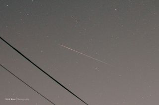 Photographer and skywatcher Nick Rose snaps photo of Perseid meteor from Millbrae, Calif., on Aug. 10, 2011.