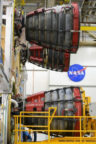 The third RS-25 rocket engine is mounted on the core of the first rocket of NASA's Space Launch System.
