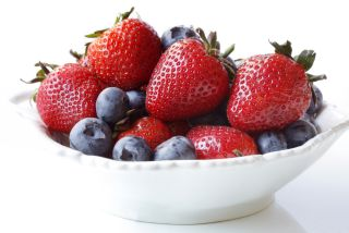 A bowl of blueberries and strawberries.
