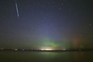 A Taurid fireball descends in glowing aurora over Lake Simcoe in southern Ontario, Canada, on Nov. 9, 2015.