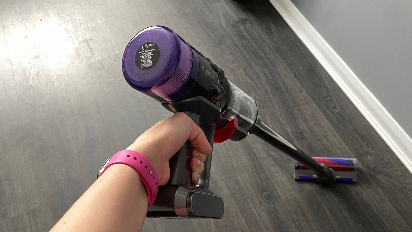 Dyson Micro 1.5kg being used to clean hard wood floors