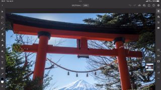 Photo of Japanese gate being edited in Photoshop