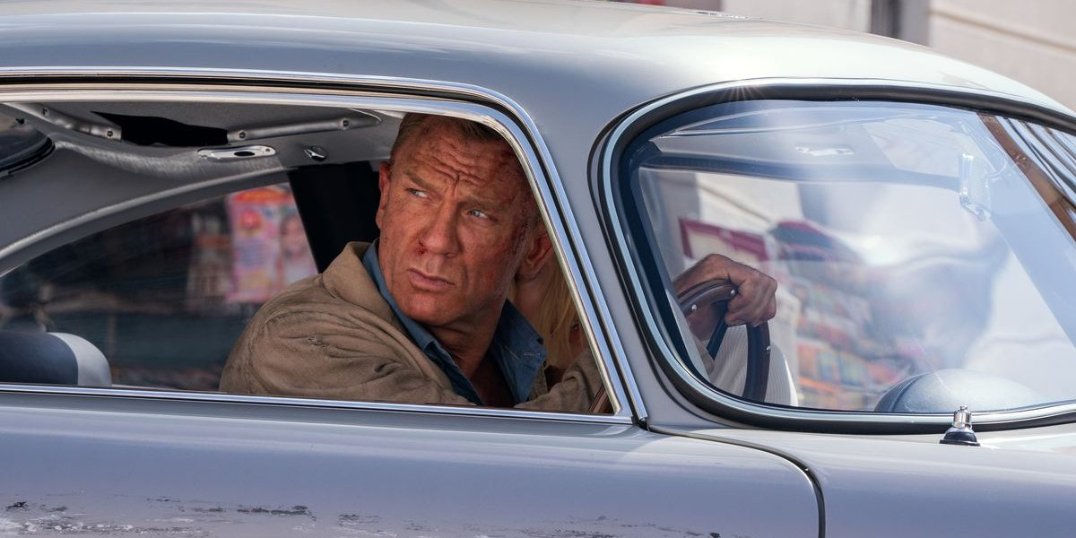 Daniel Craig glaring out of his driver's side window in No Time To Die.