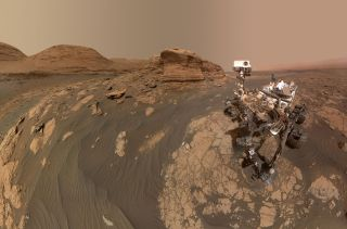 NASA's Curiosity Mars rover used two different cameras to create this selfie in front of a rock outcrop named Mont Mercou, which stands 20 feet (6 meters) tall.