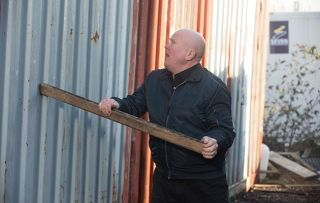 EastEnders Phil Mitchell bangs on a shipping container