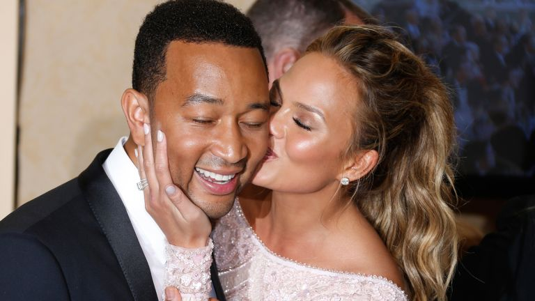 John Legend (L) and model Chrissy Teigen pose in the press room during the 72nd Annual Golden Globe Awards at The Beverly Hilton Hotel on January 11, 2015 in Beverly Hills, California