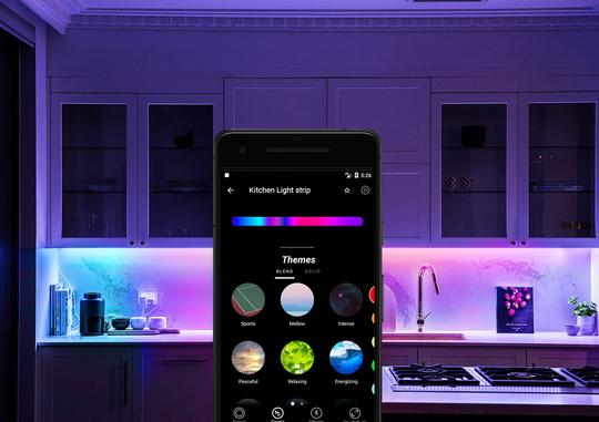 LIFX smartphone app in a kitchen illuminated with LIFX smart lights