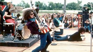 "The rock group MC5 (L-R Dennis ""Machine Gun"" Thompson, Wayne Kramer, Fred ""Sonic"" Smith and Rob Tyner) perform live in 1969 in Mount Clemens, Michigan"