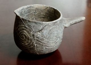 A pre-Columbian pottery vessel used for black drink.