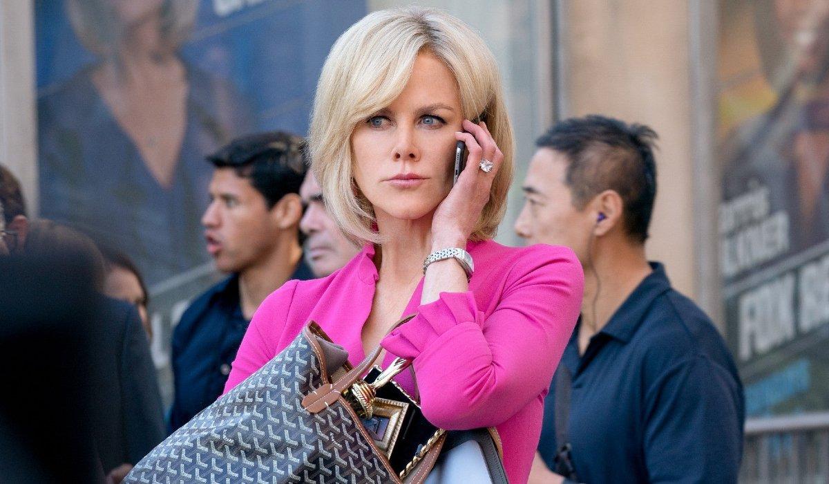 Bombshell Nicole Kidman taking a phone call outside