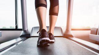 Treadmill vs running outside: image of running shoes on treadmill