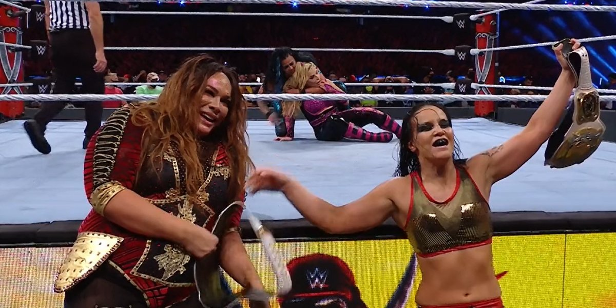 Nia Jax and Shayna Baszler after defending their titles at WrestleMania 37