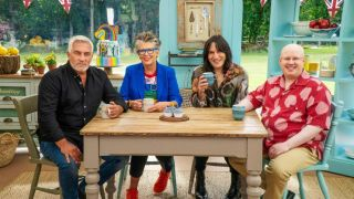 Paul Hollywood, Prue Leith, Noel Fielding, and Matt Lucas sit at a table with some cakes on it