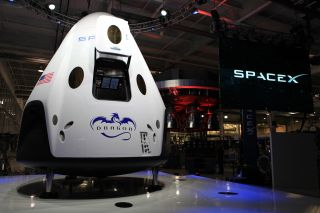 SpaceX unveiled its Dragon V2 spacecraft on May 29, 2014, showcasing a 21st-century space capsule built to carry astronauts into orbit. SpaceX founder and CEO Elon Musk detailed aspects of the design that was developed in partnership with NASA's Commercia
