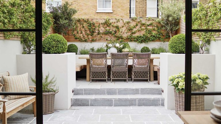 small garden design mistakes – tiered plot with paving