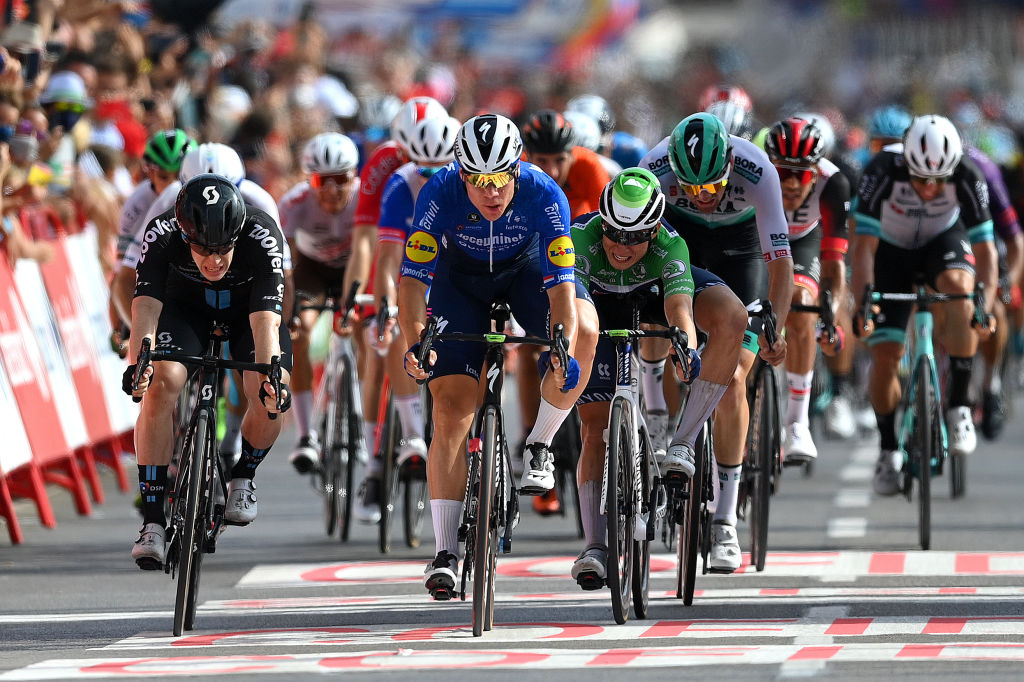 LA MANGA SPAIN AUGUST 21 Fabio Jakobsen of Netherlands and Team Deceuninck QuickStep sprints to win ahead of Alberto Dainese of Italy and Team DSM and Jasper Philipsen of Belgium and Team AlpecinFenix green points jersey during the 76th Tour of Spain 2021 Stage 8 a 1737 km stage from Santa Pola to La Manga del Mar Menor lavuelta LaVuelta21 on August 21 2021 in La Manga Spain Photo by Stuart FranklinGetty Images