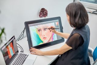 Woman using a Wacom 22