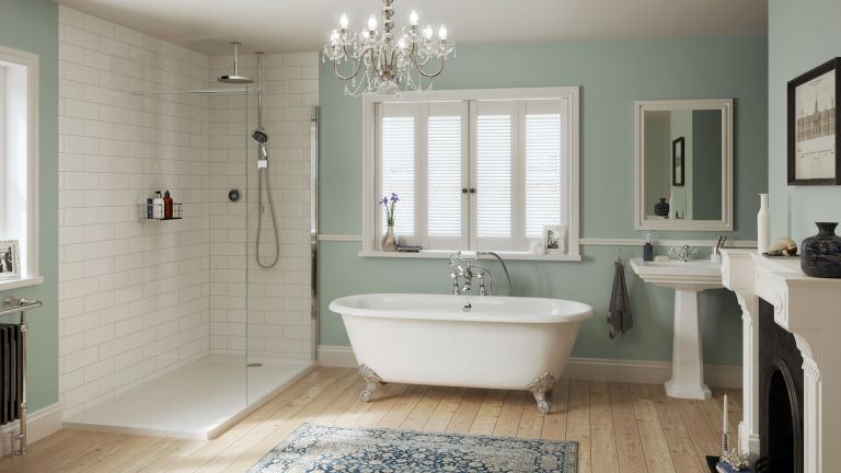 A white Mira Platinum shower in pale blue bathroom illustrating How to choose a shower for a bathroom.