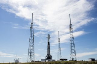A SpaceX Falcon 9 rocket carrying 60 new Starlink internet satellites for the Starlink-3 mission stands atop Space Launch Complex 40 at the Cape Canaveral Air Force Station in Florida one day before its planned Jan. 27, 2020 launch into orbit.