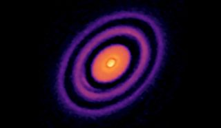An image of a protoplanetary disk and black gaps marking where planets are formed, as captured by the Atacama Large Millimeter/submillimeter Array telescope in Chile.