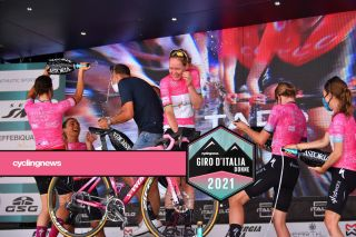 CORMONS ITALY JULY 11 Anna Van Der Breggen of Netherlands and Team SD Worx Pink Leader Jersey and teammates celebrates at podium during the 32nd Giro dItalia Internazionale Femminile 2021 Stage 10 a 113km stage from Capriva del Friuli to Cormons Trophy Super Team Champagne GiroDonne UCIWWT on July 11 2021 in Cormons Italy Photo by Luc ClaessenGetty Images