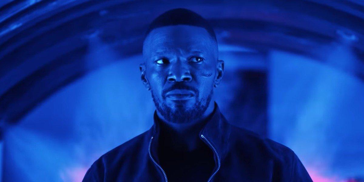 Project Power Jamie Foxx walking in a blue room