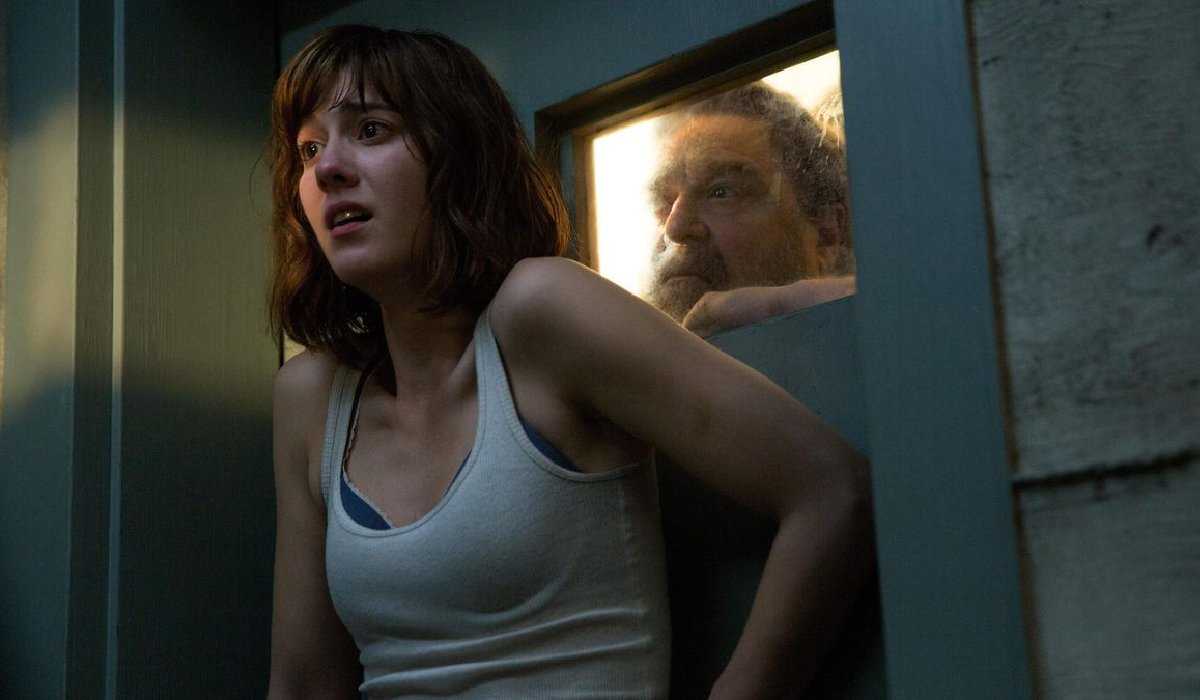 10 Cloverfield Lane Michelle in shock with Howard watching behind the door